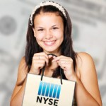 Woman holding shopping bag labeled NYSE